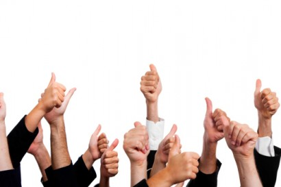 Business People with Thumbs Up on White Background.